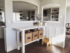 Here's a split level where they kept the corner wall between the kitchen and living area...maybe we could do this, but with smaller pass throughs to accommodate a pantry?