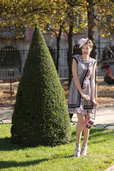 Monica Tand wearing Chanel dress and shoes, MiniMe Paris hat, Olympia Le-Tan bag in Paris.