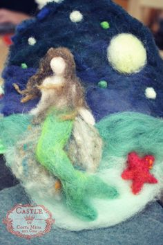 131203 Jzin's wool needle-felted picture of mermaid with green tail on a rock in the moonlight.