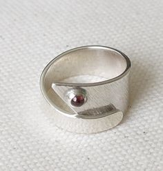Silver textured wrap ring with 3mm garnet cabochon