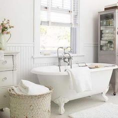 Our cottage has the old black and white honed marble mosaic floor.  Since we will keep the vintage pieces that won't overwhelm us, we could consider an all white bathroom utilizing textures of white and single accessory colors.