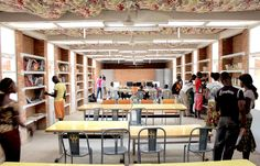 This simple building is an example of a well-thought, inexpensive, yet very functional community library. It was built in Komsliga Department, Burkina Faso Fabric Ceiling, Load Bearing Wall, Community Library, Library Inspiration, Modern Library, Library Displays, Learning Spaces, Reading Room, Interior Lighting