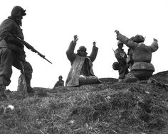 Korean War - HD-SN-99-03152 by Morning Calm News, via Flickr Men of the 1st Marine Division capture Chinese Communists during fighting on the central Korean front. Hoengsong, March 2, 1951. Pfc. C. T. Wehner. (Marine Corps) NARA FILE #: 127-N-A6759 WAR & CONFLICT BOOK #: 1493
