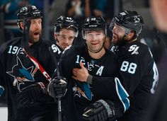 San Jose Sharks defensemen Brent Burns, Marc-Edouard Vlasic and forwards Joe Thornton and Patrick Marleau celebrate the Sharks' win over the Toronto Maple Leafs (Jan. 15, 2015).