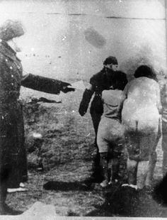Naked women being forced to undress and led to an extermination site in Latvia.. All of the killing was being filmed by German soldiers. World War Two