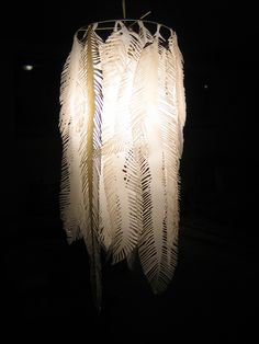 chandelier of feathers cut from milk bottles