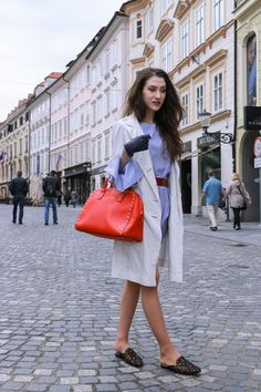 Fashion blogger Veronika Lipar of Brunette From Wall Street sharing her spring street style on the streets of Ljubljana
