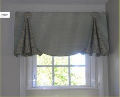 Custom Valance. Shaped valance with fullness behind pleats. Covered button detail.