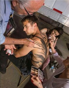 I would watch while they put his tattoo on Theo James aka Tobias 'Four' Eaton #Divergent