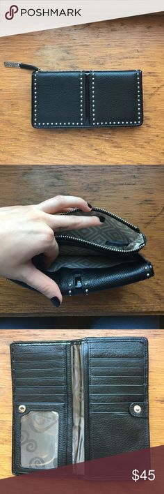 """Brighton Wallet PRODUCT DETAILS Product is brand new. Width: 7 1/4"""" Height: 3 5/8"""" Depth: 1 1/4"""" Credit Card Slots: 11 Interior Pockets: 4 Exterior Material: Leather Exterior Pockets: 1 Closure: Magnetic flap Features: ID window Brighton Bags Wallets"""