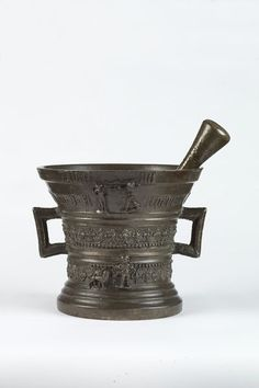 This is a Mortar & Pestle, made in Hengelo, Netherlands, in 1540. It was used by painters, craftsmen, alchemists, for cosmetics, medicines, food preparation etc. It is even still used today. The user mashes up ingredients with it. It would have been used by many in Europe  who were making medicines and herbal concoctions.