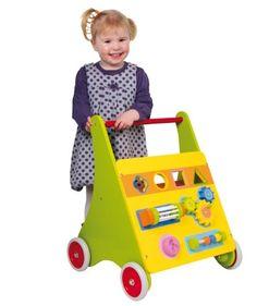 CARRITO DE PRIMER PASO MICO Este juguete no es sólo un atrapa miradas, sino también ayuda al niño a aprender a caminar y a la coordinación de ojos y manos. Está elaborado de madera barnizada en colores, tiene ruedas dentadas, un cilindro con campanas o botón que al girarlo suena, lleva formas geométricas con sus respectivos agujeros. ¡Aquí sus hijos aprenderán de todo!   Dimensiones. 43 x 40 x 52 cm  Edad recomendada: +18meses.