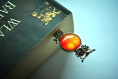 Handmade bookmark with a base in a shape of owl with orange graphics under glass caboshon  Size of graphics: 2 cm Total lenght: 9 cm  Perfect gift for those who love spending long evenings with a book