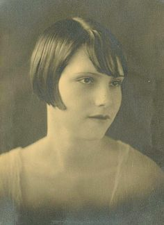 Anonymous young lady with bobbed hair