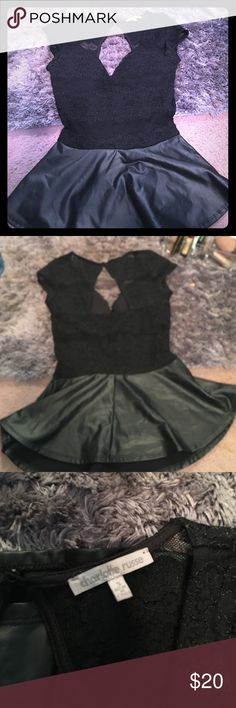 Leather and lace peplum top Beautiful peplum top with lace and back cut out. Bottom half is leather. Love this but it's too small for me. Charlotte Russe Tops Blouses