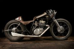 """This one-of-a-kind cafe racer is about as custom as it gets.  The crew at El Solitario in Spain built this one-off motorcycle for a competition where resources were limited, but time and creativity were not.  With a vintage Yamaha SR250, about $1300 in parts and over 500 hours of manual muscle, El Solitario designed and built the """"Winning Loser"""" motorcycle, the perfect bike for the anti-hero. - See more at: http://www.thecoolist.com/el-solitario-winning-loser-motorcycle/#sthash.OBevyxJp.dpuf"""
