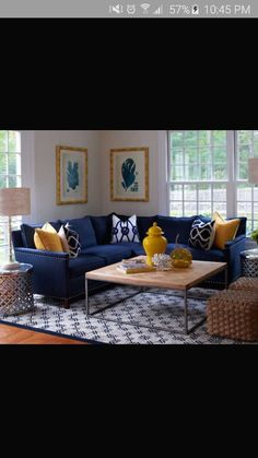 Navy couch & yellow throws. I want mint accents as well.