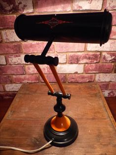 "HARLEY DAVIDSNO VINTAGE BANKER'S LAMP   SALVAGED 2-ARM ARTICULATING VINTAGE BANKERS LAMP, CIRCA 1940-1950  THEY WERE ALSO SOMETIMES REFERRED TO AS A ""PIANO LAMP"""