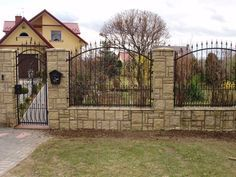 Front fence in either brick or grey stones (same as house) - not sure???  Black wrought iron fence and gate and also need a sliding driveway gate in wrought iron.