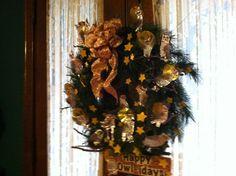 """Happy Owl-idays"" Wreath created by  Saints Mary and Mathias School, Fourth Grade"