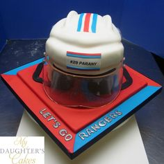 Here's a hockey helmet & mask groom's cake for a Ranger's fan. The helmet is carved in cake and the clear mask is cast entirely from sugar. Delivered to Fiddler's Elbow, Bedminster, NJ