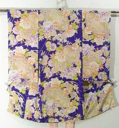 This is an elegant girl's vintage kimono with houou(phoenix) and seasonal flowers pattern such as 'kiku'(chrysanthemum), 'sakura'(cherry blossom) and 'botan'(peony) on fan, which is dyed