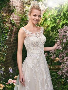 Rebecca Ingram - alexis, This flirty A-line wedding gown features distinctive crosshatch motifs embellished with Swarovski crystals, delicate beading, and sequins. Illusion details accented in lace appliqués create beautiful back interest. Finished with covered buttons over zipper closure.