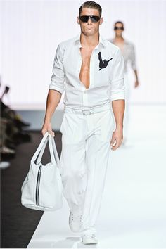 I am not a fan of logo branding but this is kind of cool.   Dirk Bikkembergs Sport Couture S/S 2012