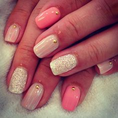 Two different tones of pink with a sliver glitter nail on ring finger with small gold balls.