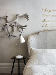 love the painted quote on the wall above the bed...