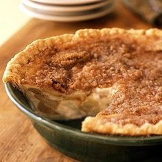 This warm apple-buttermilk custard pie is a delicious twist on a classic American dessert. The key to both a flaky piecrust and crisp streusel topping is to keep them as cold as possible before putting them into the oven.