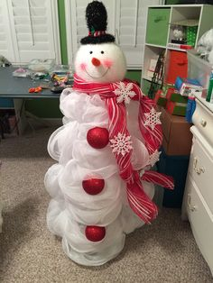 Snowman made out of mesh and tomato cage