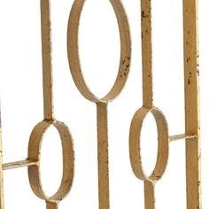 "detail: Mid-century modern style lends glamour to the open-frame design of the Zena screen by Arteriors. Its geometric iron frame creates a remarkable centerpiece in the living room or den.  Each panel: 14""W x 72""H  Iron  Distressed gold leaf finish"