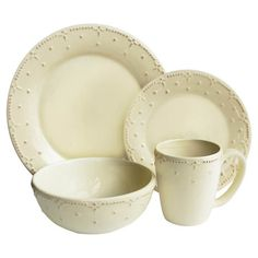 Stylist's Tip: A touch of texture sets this cream-hued dinnerware set apart. Pair it with springtime colors for a fresh tablescape, or mix and match with oth...