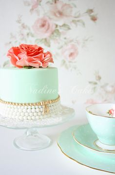 Mint cake with Gold Bow & Coral Flower Topper