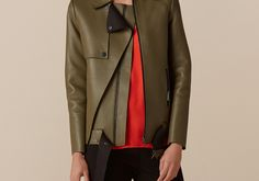 """In a matt khaki, the biker jacket evolves into bonded leather with gunmetal zips trimming cuffs and pocket fastenings, standing out against the clean cut of raw-edged double storm flaps.  <br/><br/> Straight cut for a relaxed fit <br/><br/> See """"Details & Size"""" tab for information on fibre composition, care instruction and fits."""