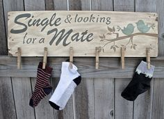 This lost sock display measures 24 wide x 7 tall (9 tall with adding the length of the clothes pins), it is painted a vintage white for the
