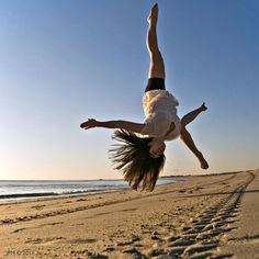 There is no better place to flip around than the beach!