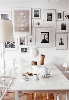 White interior with photo frames