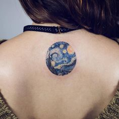 Van Gogh's 'The Starry Night' circle tattoo on the upper back.