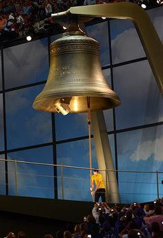 Bradley Wiggins, the first British winner of the Tour De France, rings the largest harmonically tuned bell in the world to signal the start of the ceremony