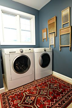 Sherman Williams Smoky blue....white trim, wood cabinets and that red rug...Laundry Room Makeover Reveal