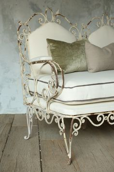 Old Iron bench beautifully upholstered...love this!