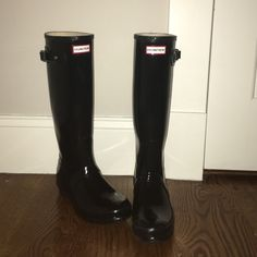 Tall black glossy hunter boots Gently used, in great conditon. Very durable and comfortable. small scuff mark (pictured). Also have my first name written inside- not visible at all when on. Have minor scratching and blooming that happens to all high quality hunter products(both barley visible) signs of gentle wear on toes. Additional pictures in separate listing shows blooming. Hunter Boots Shoes Winter & Rain Boots