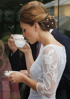 The Duke and Duchess of Cambridge drink tea at the British High Commission in  Kuala Lumpur, Malaysia, in honor of the Queen`s Diamond Jubilee.