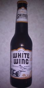 Light taste, simple and clean.  Slight lemon flavor.  Would be a good hot day beer. Shiner White Wing, Belgian White