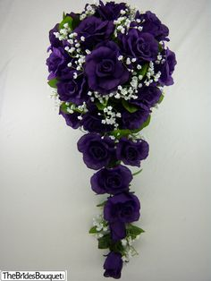 Gorgeous purple silk roses are mixed with pretty green rose leaves. We offer the most realistic roses available. If you like this photo, you will adore this wedding bouquet in person. The bouquet is c Deep Purple Wedding, Purple Wedding Bouquets, Bride Bouquets, Flower Bouquet Wedding, Flower Bouquets, Pew Flowers, Blue Bridal, Wedding Dresses, Beautiful Flowers