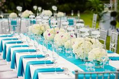Colored napkins on white linens