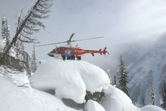 "Would you heli-ski? This photo was taken at CMH Monashees in the Rocky Mountains near Vernon, British Columbia titled ""Now that is what I call a landing!"" Xtreme skiers are always looking for the deepest powder, the hardest descent, and the thrill. A helicopter drops the skiers off at a remote, but safe, location on a mountain along with (usually) two guides. The helicopter returns to its base (often a backcountry lodge) and the adventure begins..."