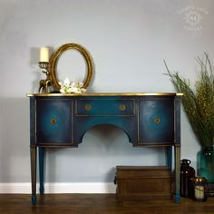 Sold! This teal serpentine sideboard was painted in London Vintage Furniture Paint colour Hove Sea with lots of Annie Sloan black wax and Rustoleum gold paint.